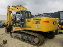 Retro excavadora Kobelco SK210. (